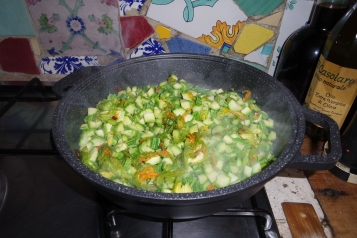 She uses all parts of the zucchini - blossoms and stems included.